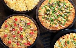 Pizzas made using Grandmas Secret recipe- Junos Pizza