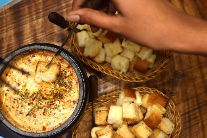 Dunk in the Cheesy Pizza Fondue and Board Games at Uncafe!