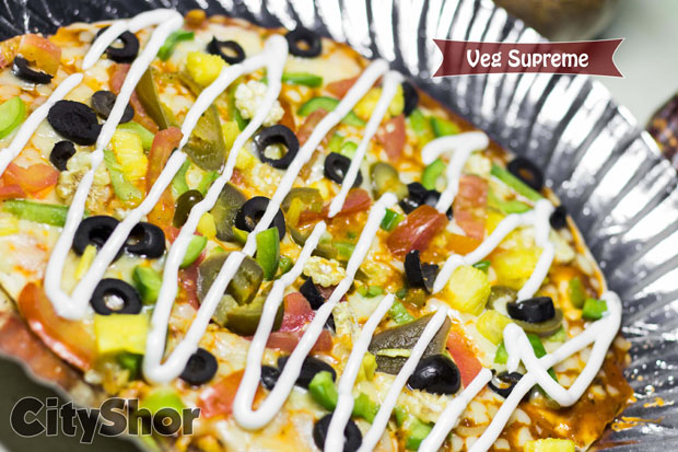 Munch the loftiest Pizzas of Surat at Smokeys