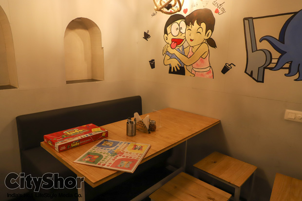 Eat.Shop.Chill.Repeat. at Cartoon-themed cafe in a Boutique