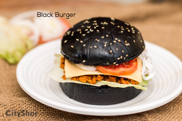 A Food Truck that serves Quirky Black&Orange Burgers & More!